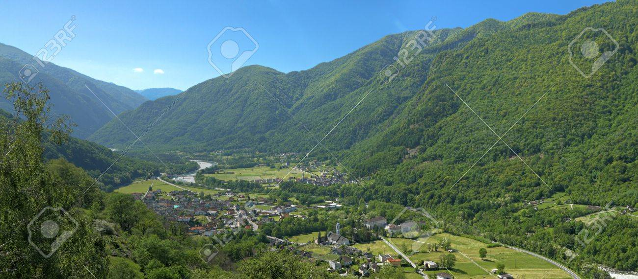 Small Town In The Maggia Valley Framed By High Green, Wooded.. Stock ...