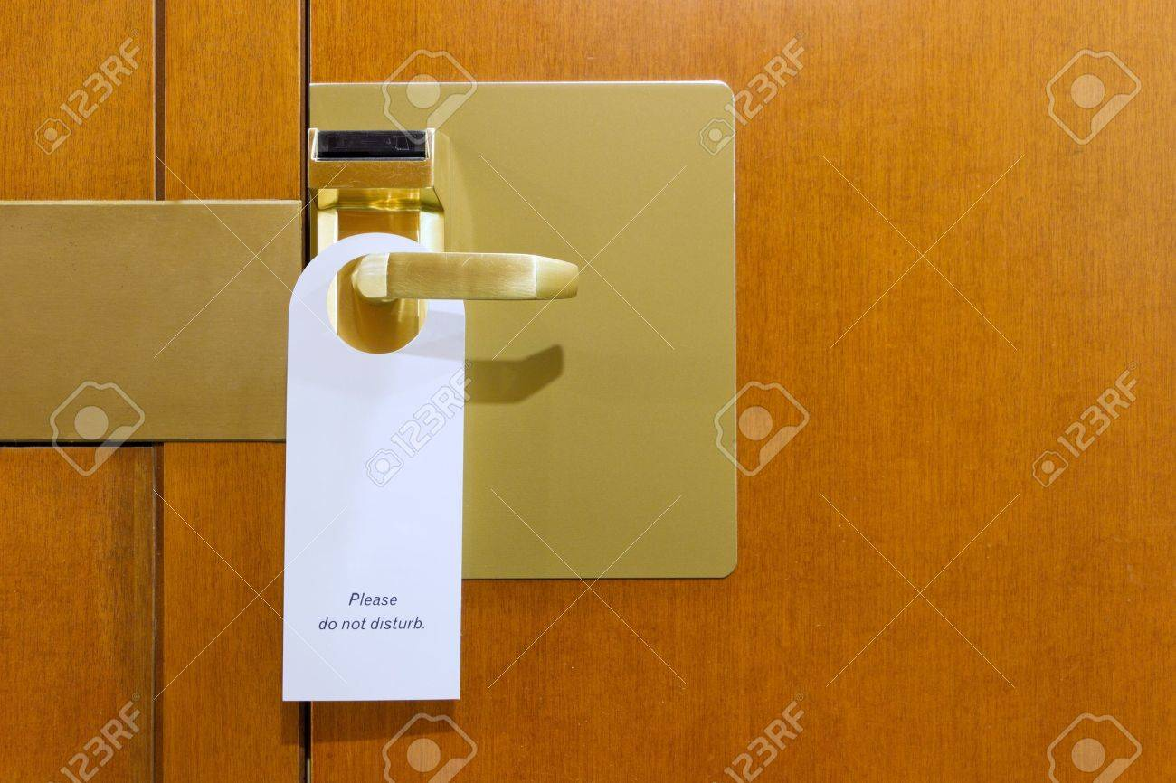 classic do not disturb sign on brass and wood hotel room door cleaned with copyspace for your text Stock Photo - 11943365