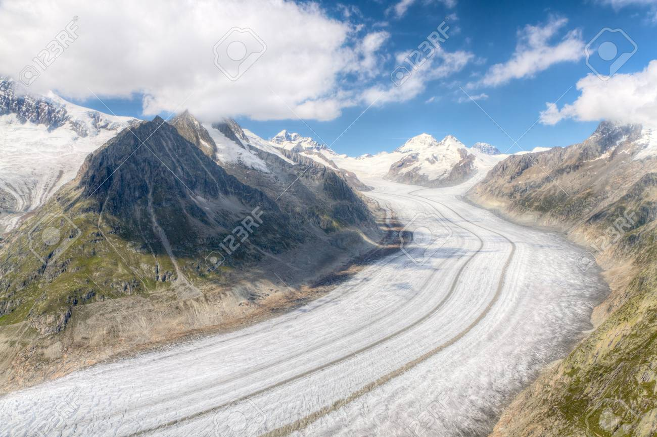 concept for hiking, climbing, walkig and outdoor adventures:  panorama view above long Aletsch glacier Switzerland Stock Photo - 12875959