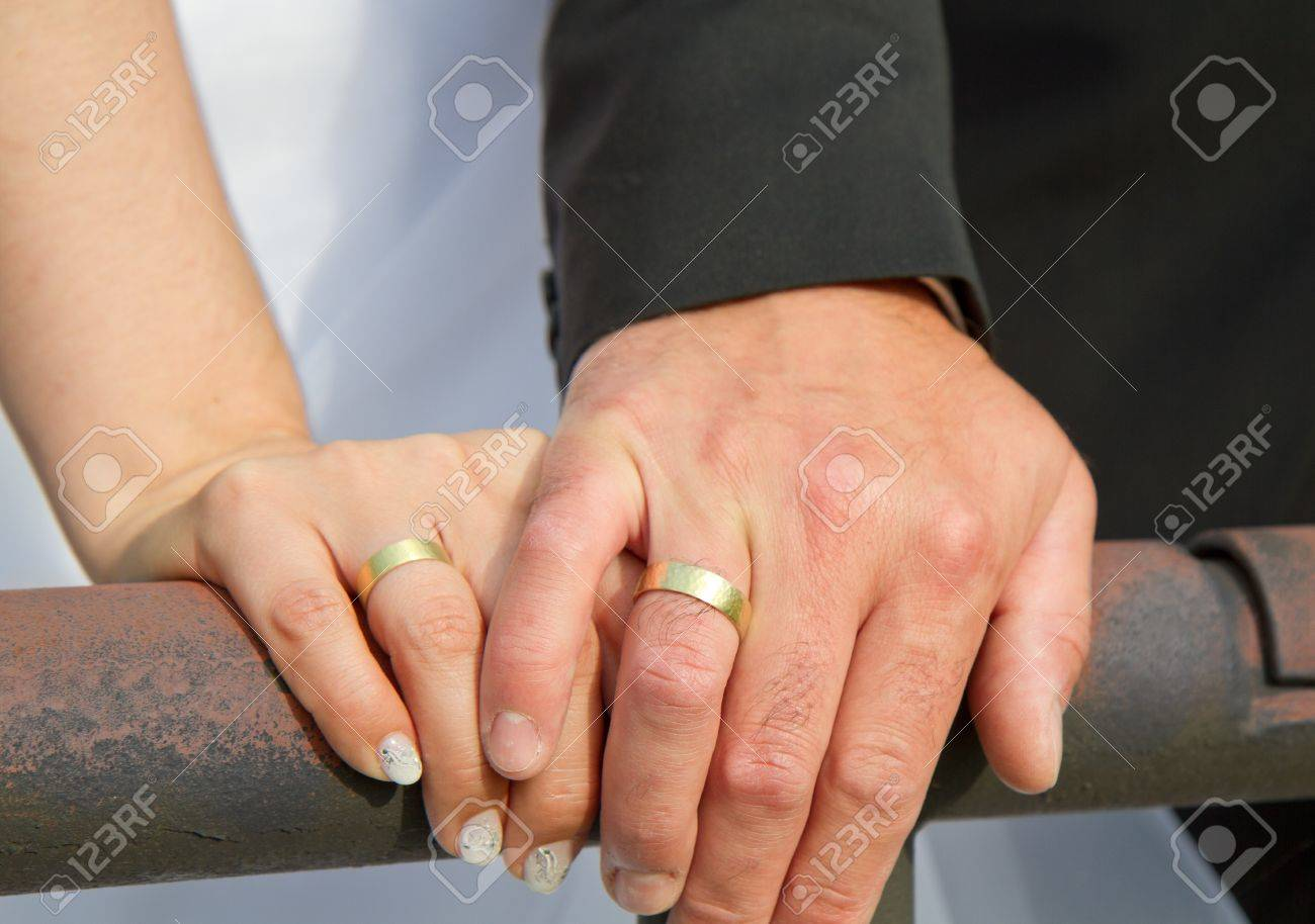Married Couple Holds Hands And Shows Of There Golden Wedding Stock