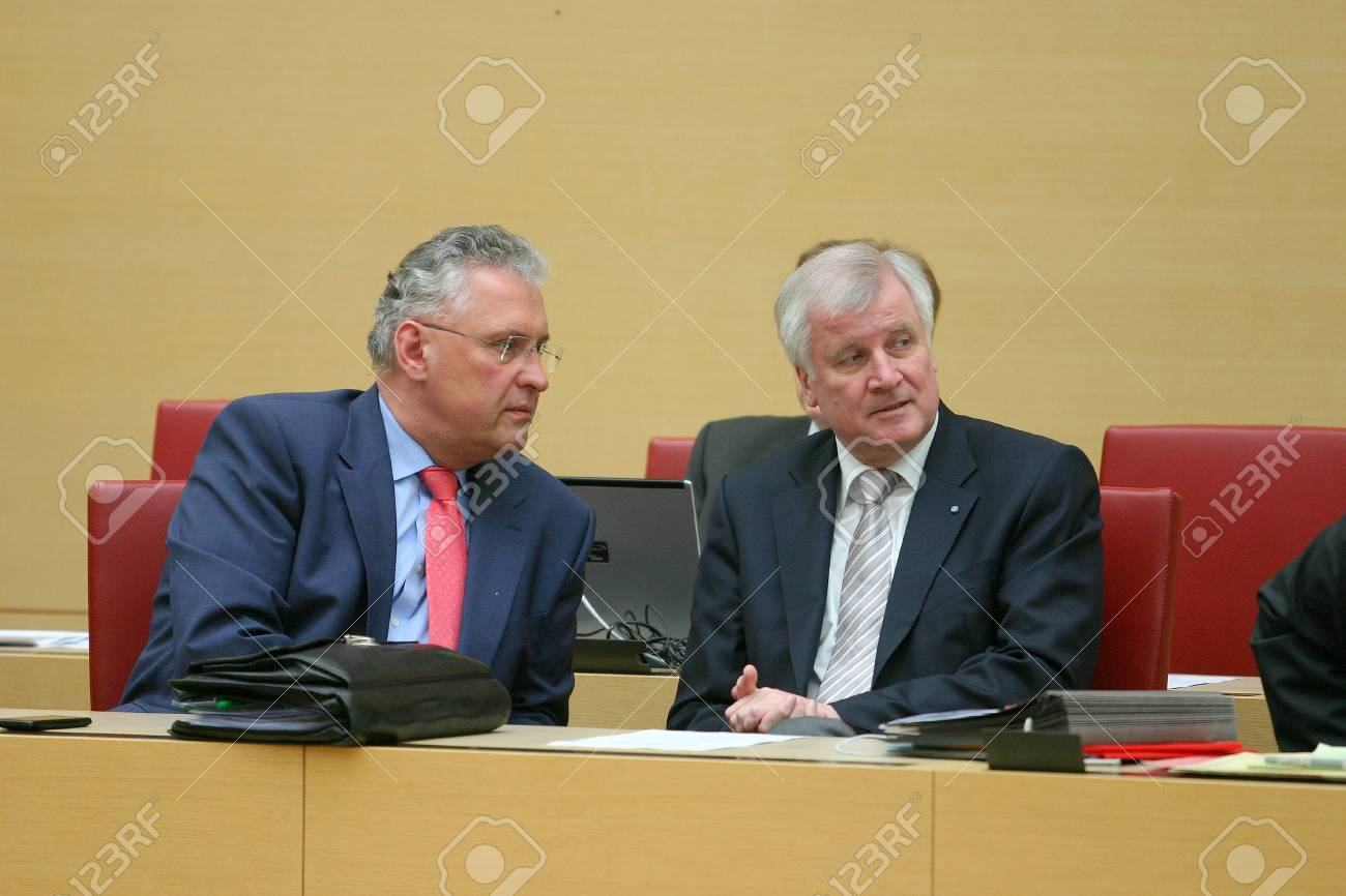 April 11, 20143 - Horst Seehofer (CSU, right), Minister President of Bavara, in conservation with Joachim Herrmann (CSU), Minister of the Interior of Bavaria in Bavarian Parliament Standard-Bild - 87197627