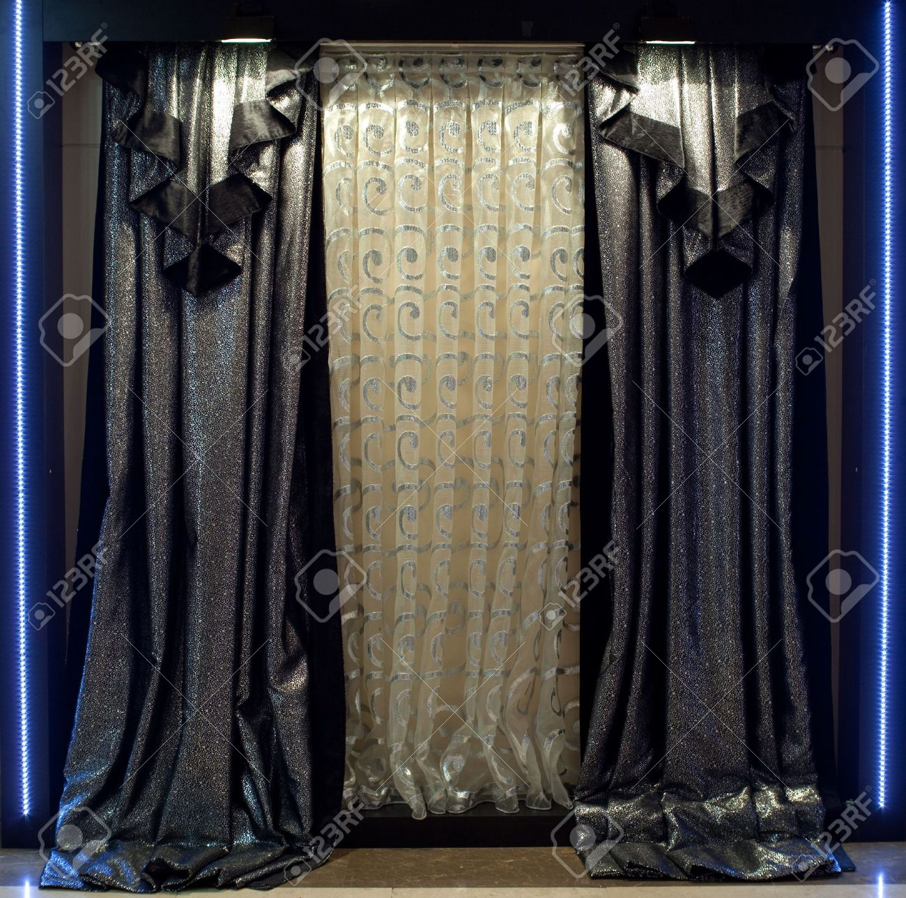 Designer Window Panels luxurious designer window curtains in silver and white stock photo