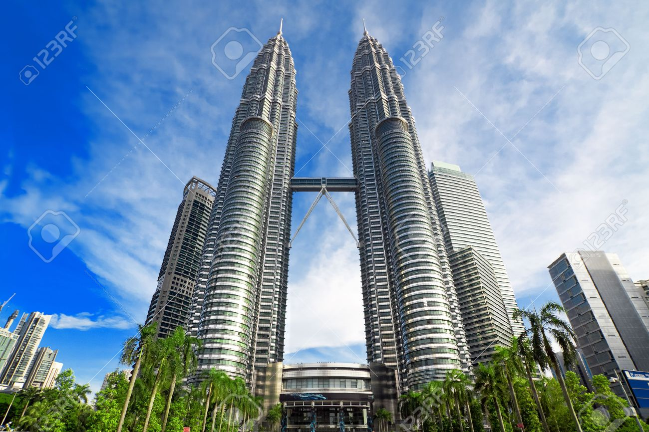 KUALA LUMPUR, MALAYSIA - JANUARY 8: Petronas Twin Towers at day on January 8, 2014 in Kuala Lumpur. Petronas Twin Towers were the tallest buildings (452 m) in the world from 1998 to 2004 - 28893739