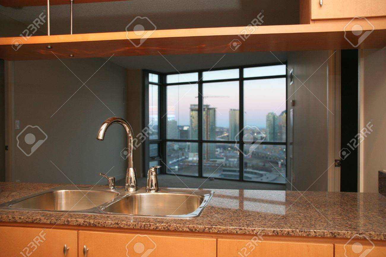 small condo apartment kitchen with sink and tap and marble counter tops Stock Photo - 1006490