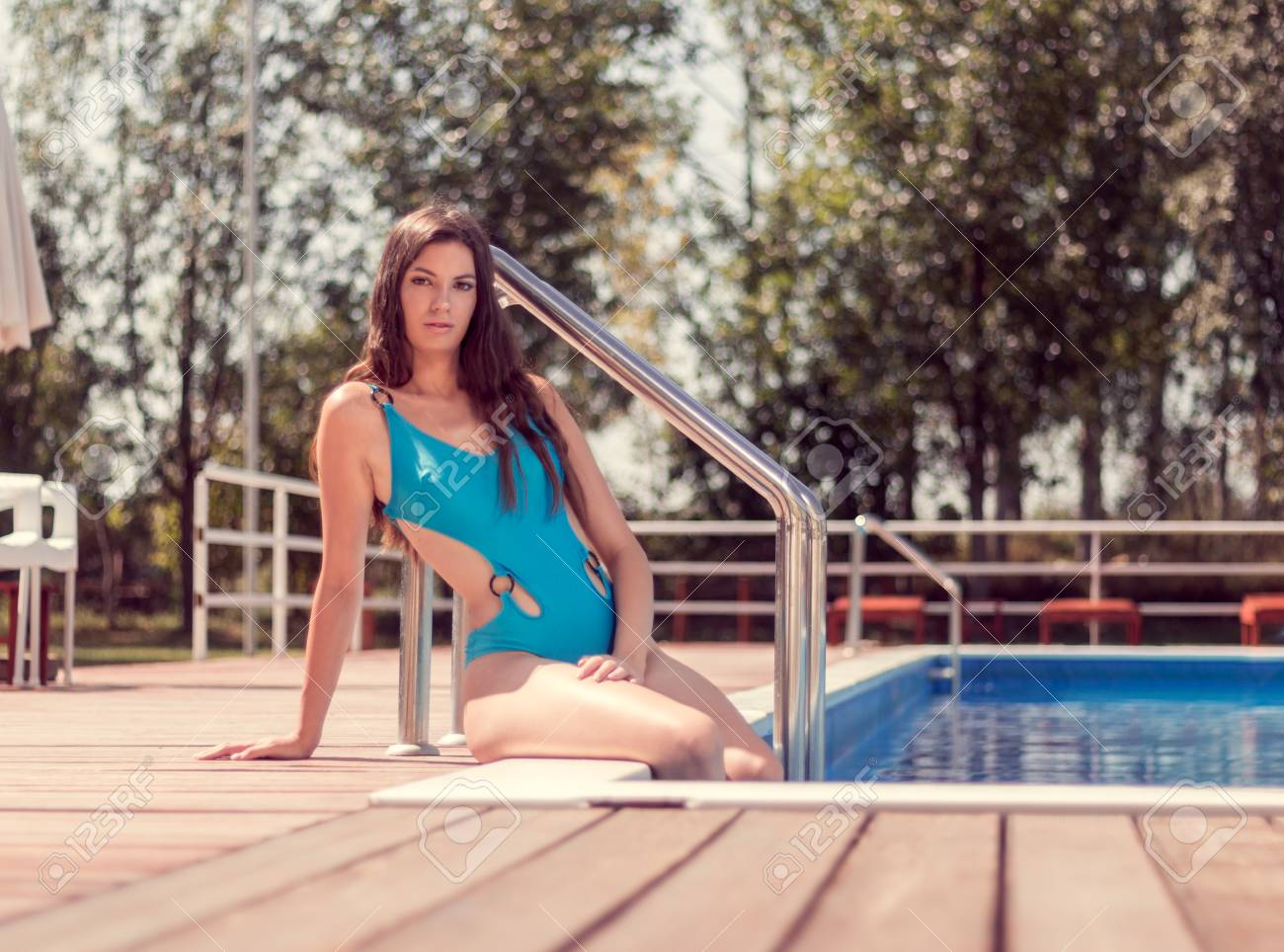 one young adult woman Caucasian model posing, long hair, sitting..
