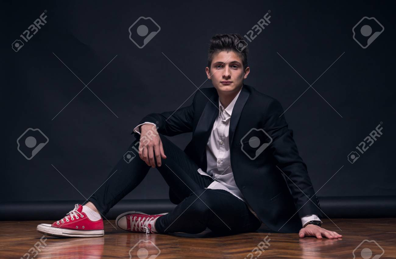 One Young Teenage Boy Black Background Studio Sitting Posing Stock Photo Picture And Royalty Free Image Image 85998209