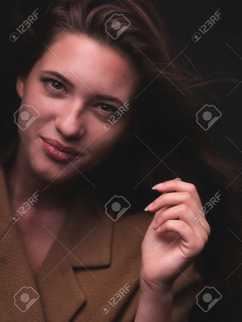 conceptual portrait, one young beautiful woman wraped in plastic sheet. Shot in studio, white background. - 164118952