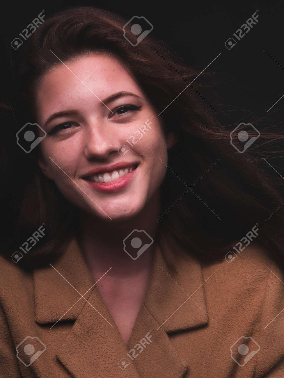 high key. Conceptual portrait with plastic sheets. One young woman strugling with plastic sheets. - 164118905