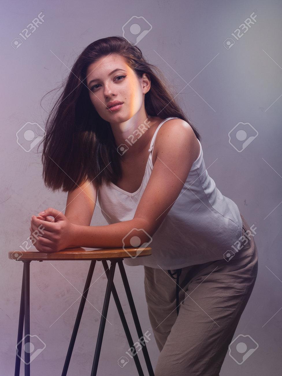 high key. Conceptual portrait with plastic sheets. One young woman strugling with plastic sheets. - 164118907