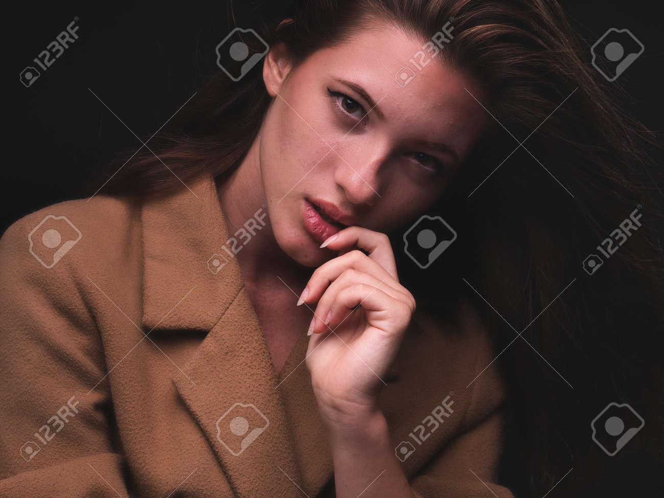 high key. Conceptual portrait with plastic sheets. One young woman strugling with plastic sheets. - 164118910