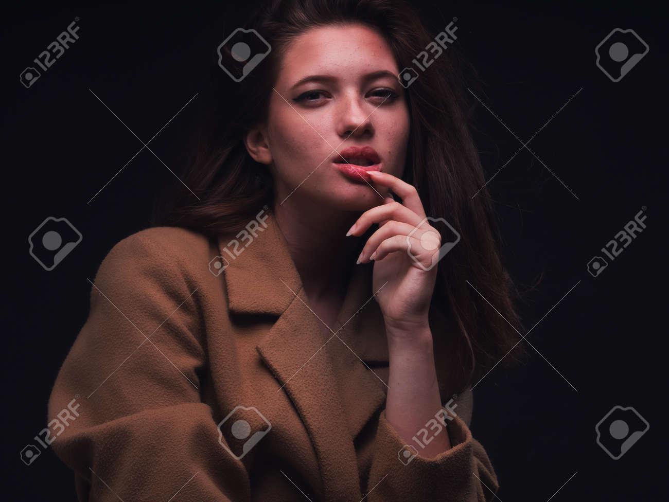 high key. Conceptual portrait with plastic sheets. One young woman strugling with plastic sheets. - 164118911