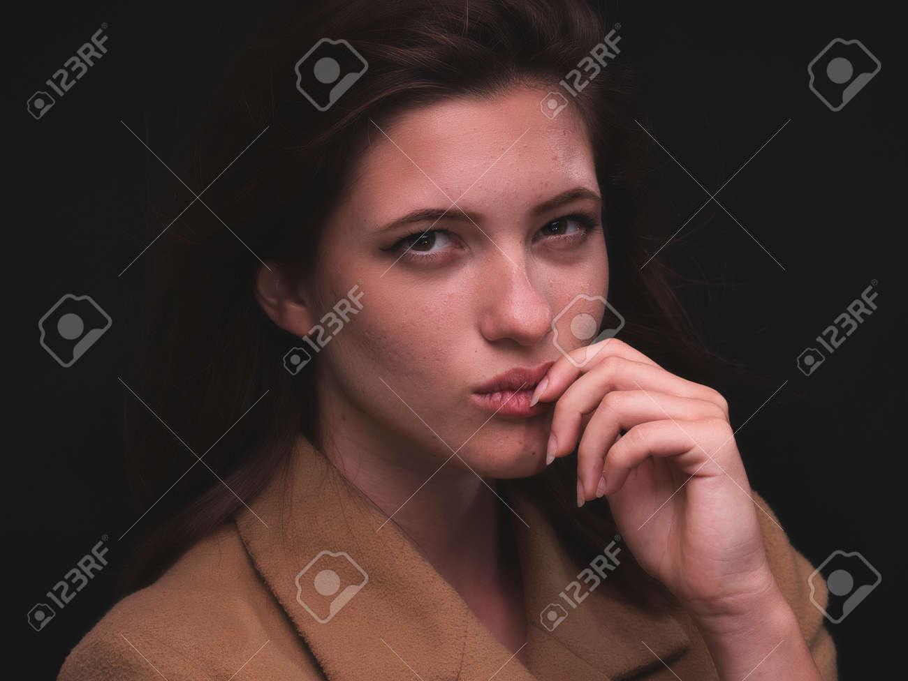 high key. Conceptual portrait with plastic sheets. One young woman strugling with plastic sheets. - 164118913
