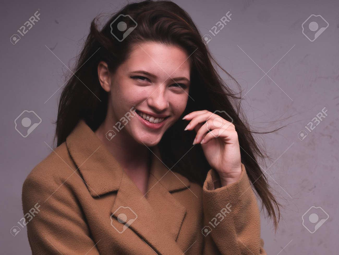 high key. Conceptual portrait with plastic sheets. One young woman strugling with plastic sheets. - 164118922