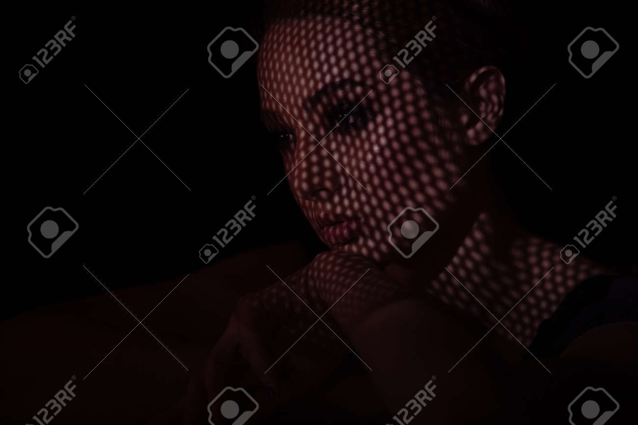Close up portrait of dissapointed and sad young women. Night mood. - 169886824