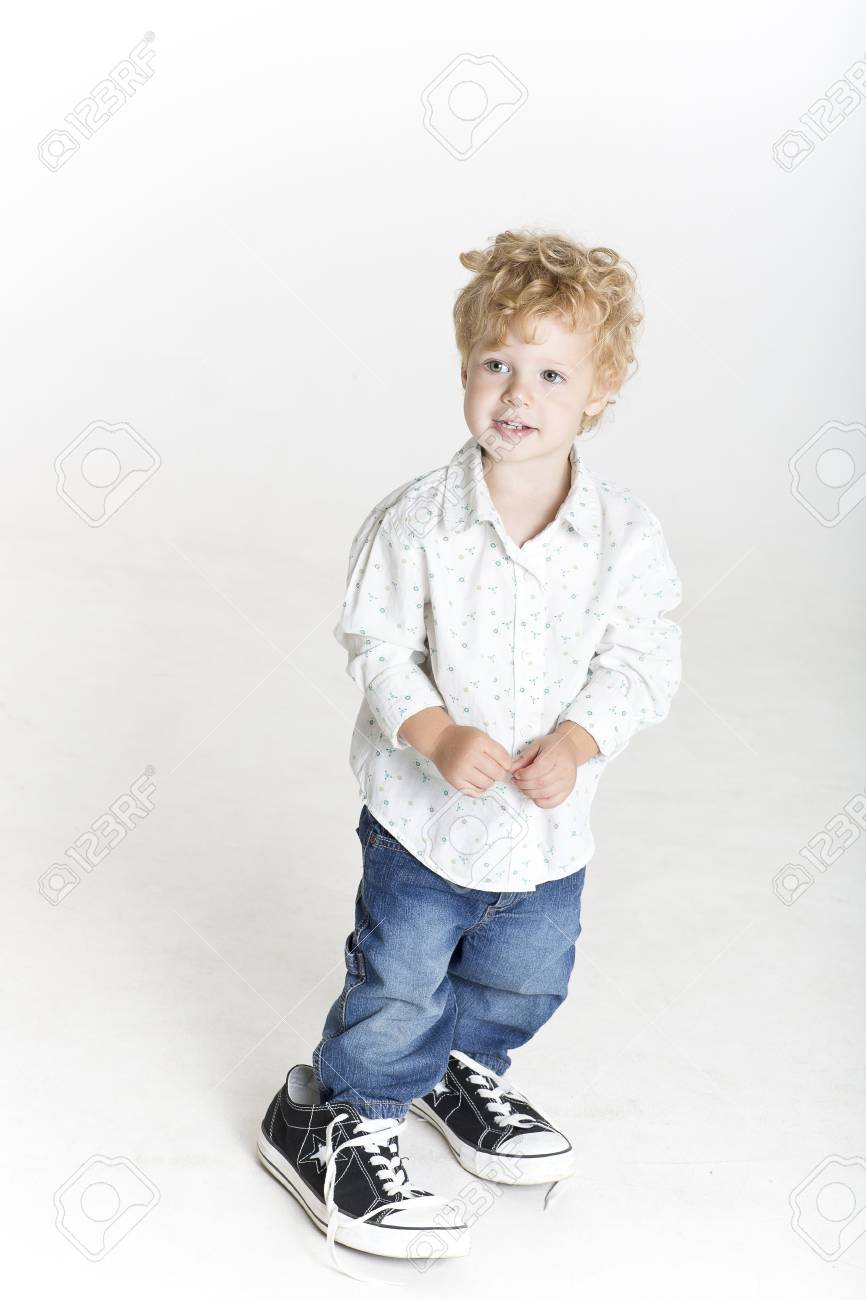 Small Boy Is Trying On Big Shoes Stock
