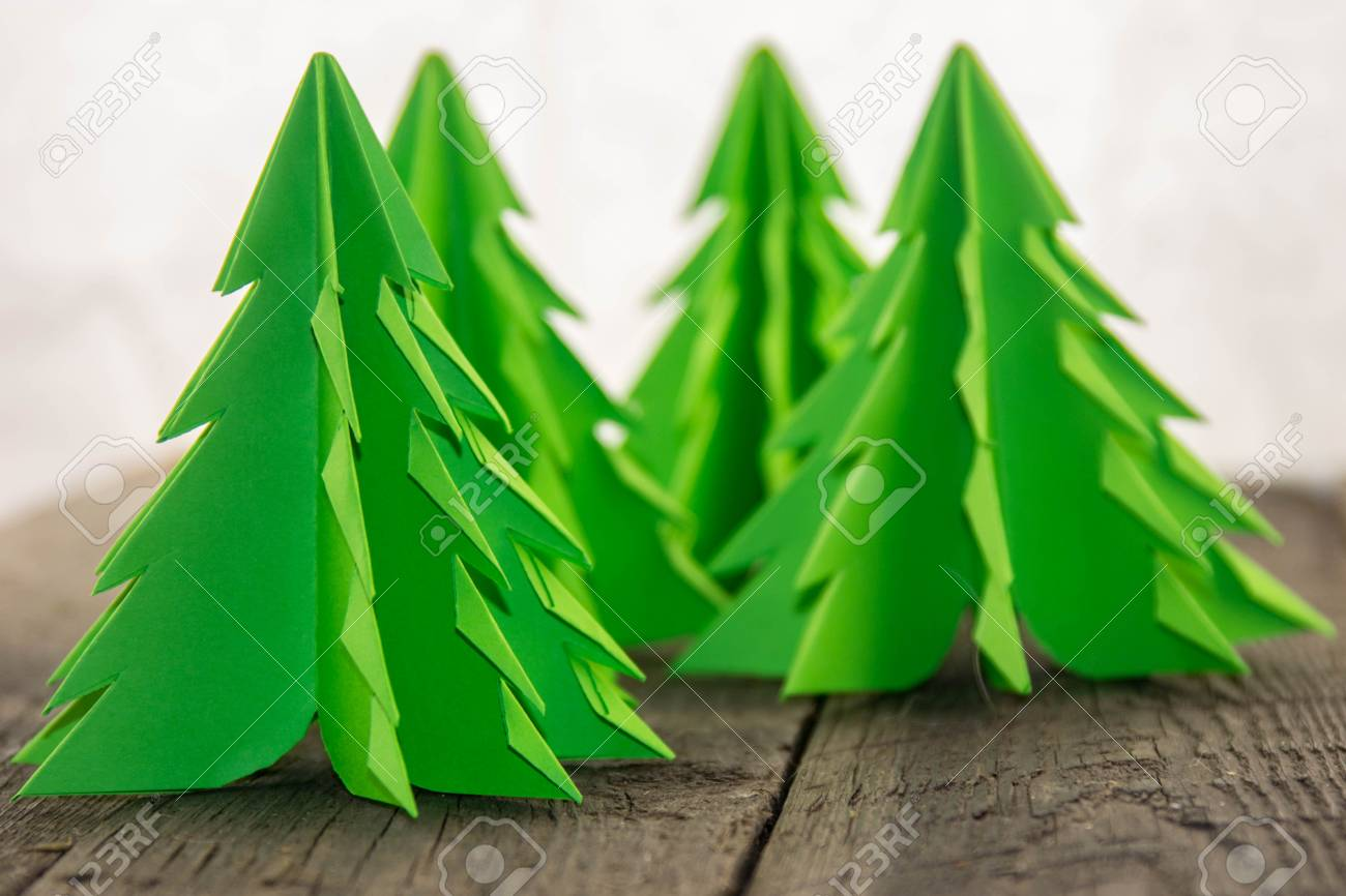 Origami Christmas.Origami Christmas Tree On A Wooden Base