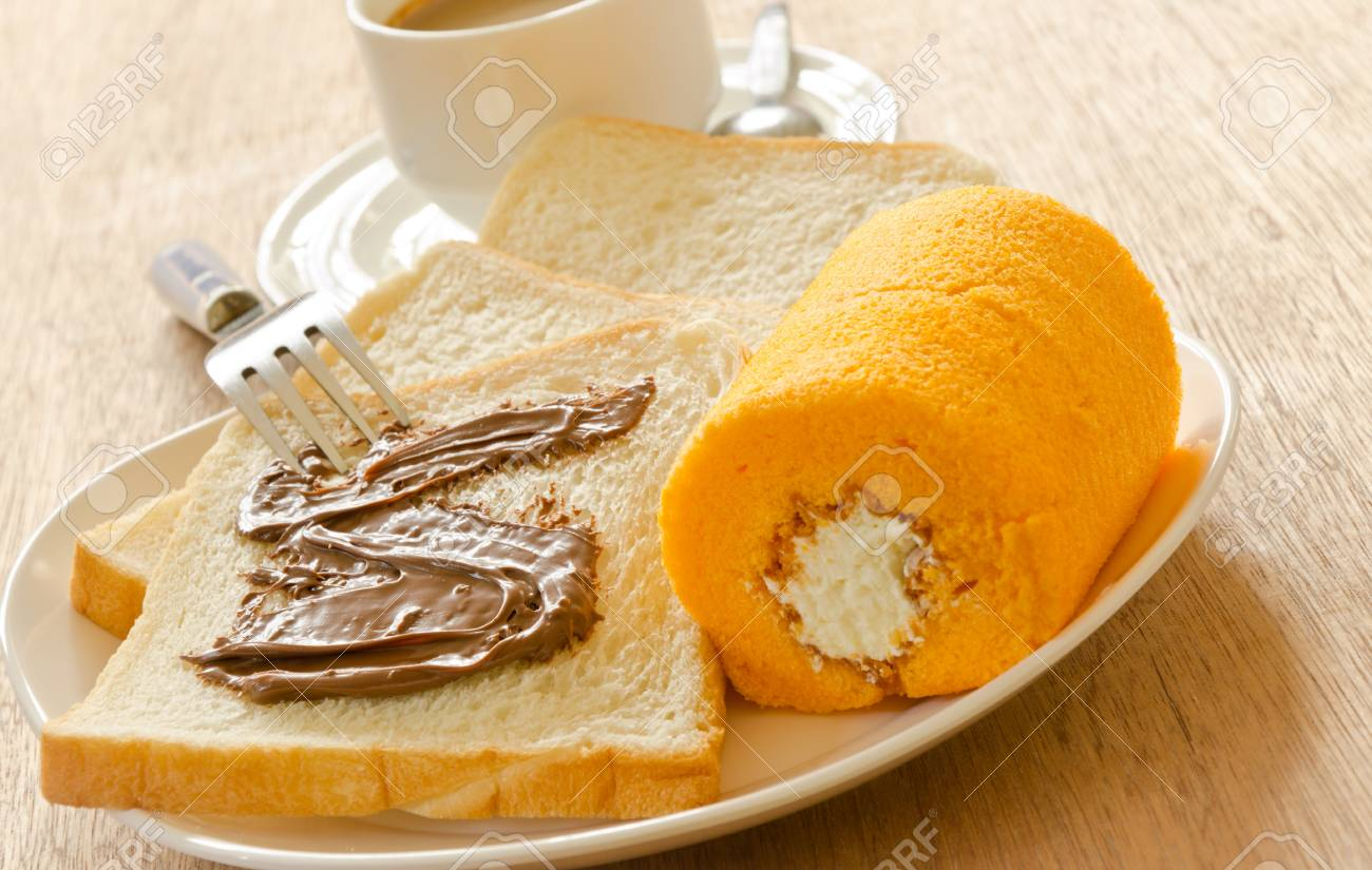 Slice bread with chocolate and cake roll Stock Photo - 13215431