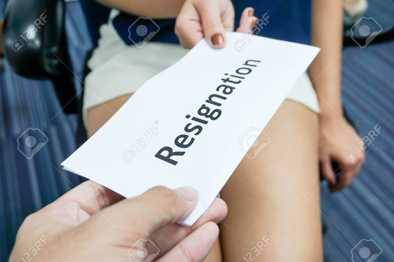 woman submit a resignation letter to the boss stock photo picture