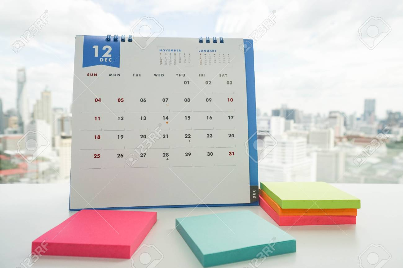 december calendar with sticky notes for meeting reminder stock photo