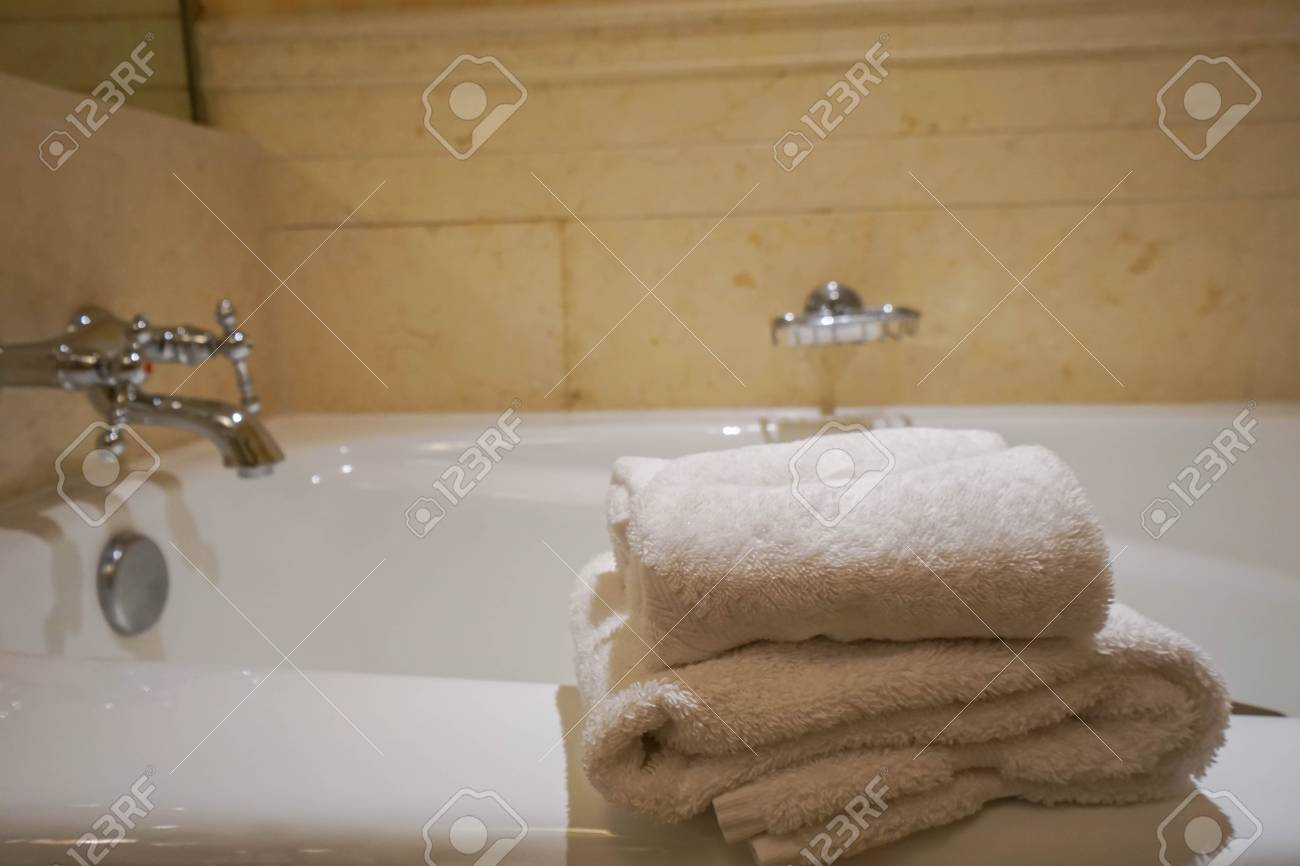 Stack Of White Towel On Bathtab In Bathroom Stock Photo, Picture And ...