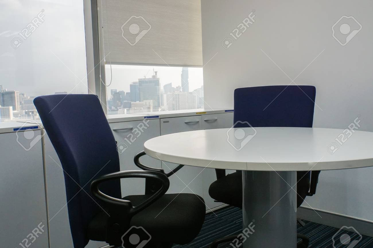 office chair and white round table in meeting room