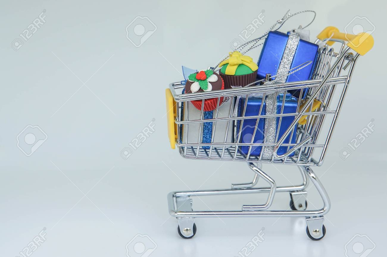 Isolated Shopping Cart Full Of Birthday Gifts For Children Stock Photo