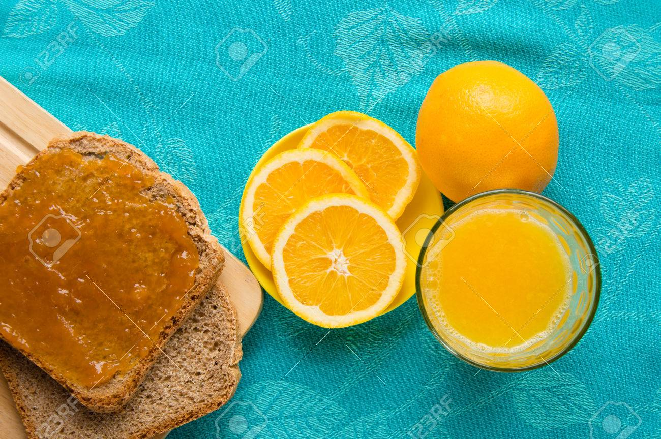 Good morning with orange juice, bread and jam Stock Photo - 48982183