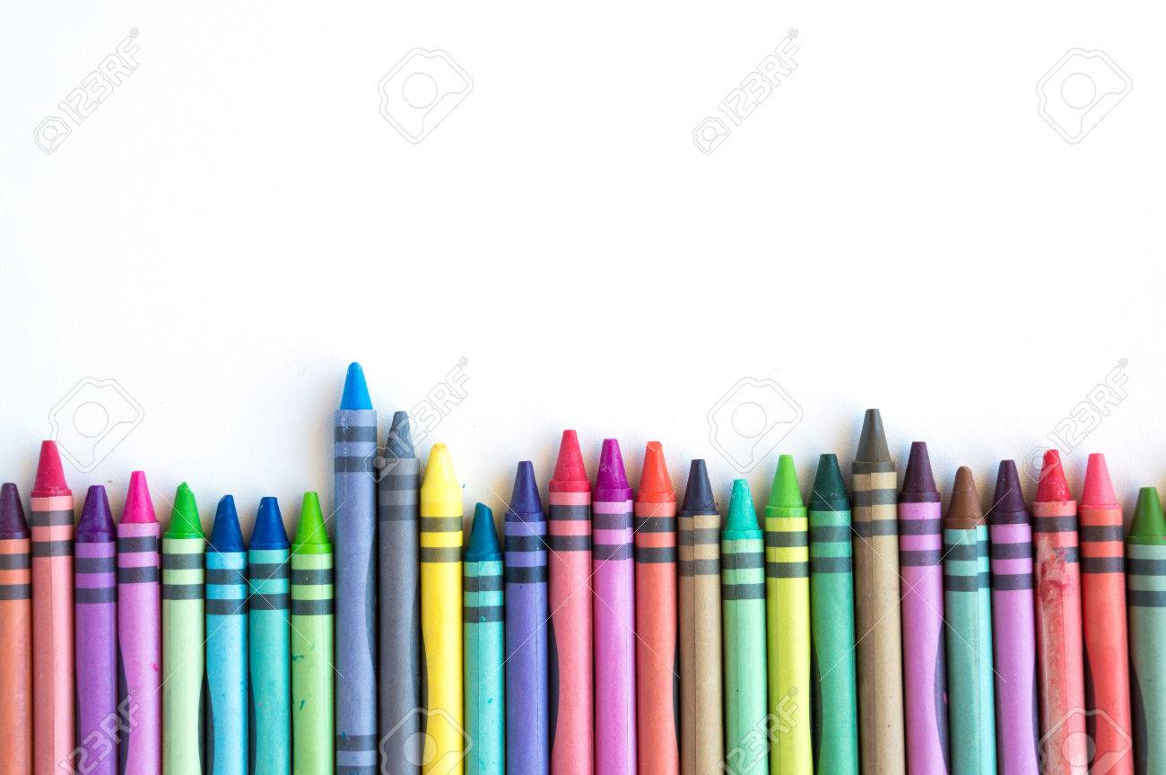 Crayons and pastels lined up in rainbow isolated on white background. Stock Photo - 52508447