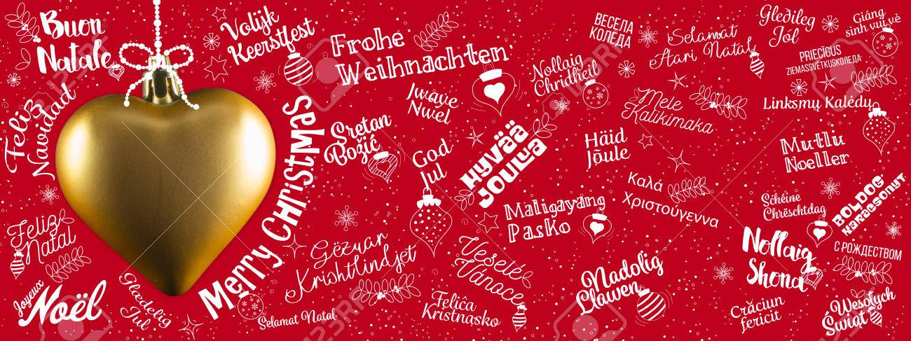 Merry Christmas greetings web banner from world in different languages with golden heart, calligraphic text and font handwritten lettering Stock Photo - 66948464