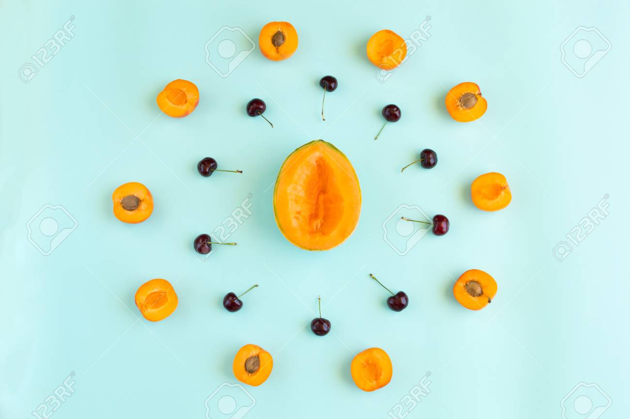 Colorful summer fruits pattern with melon slices, apricots and cherries isolated on azure aquamarine background Stock Photo - 80170125