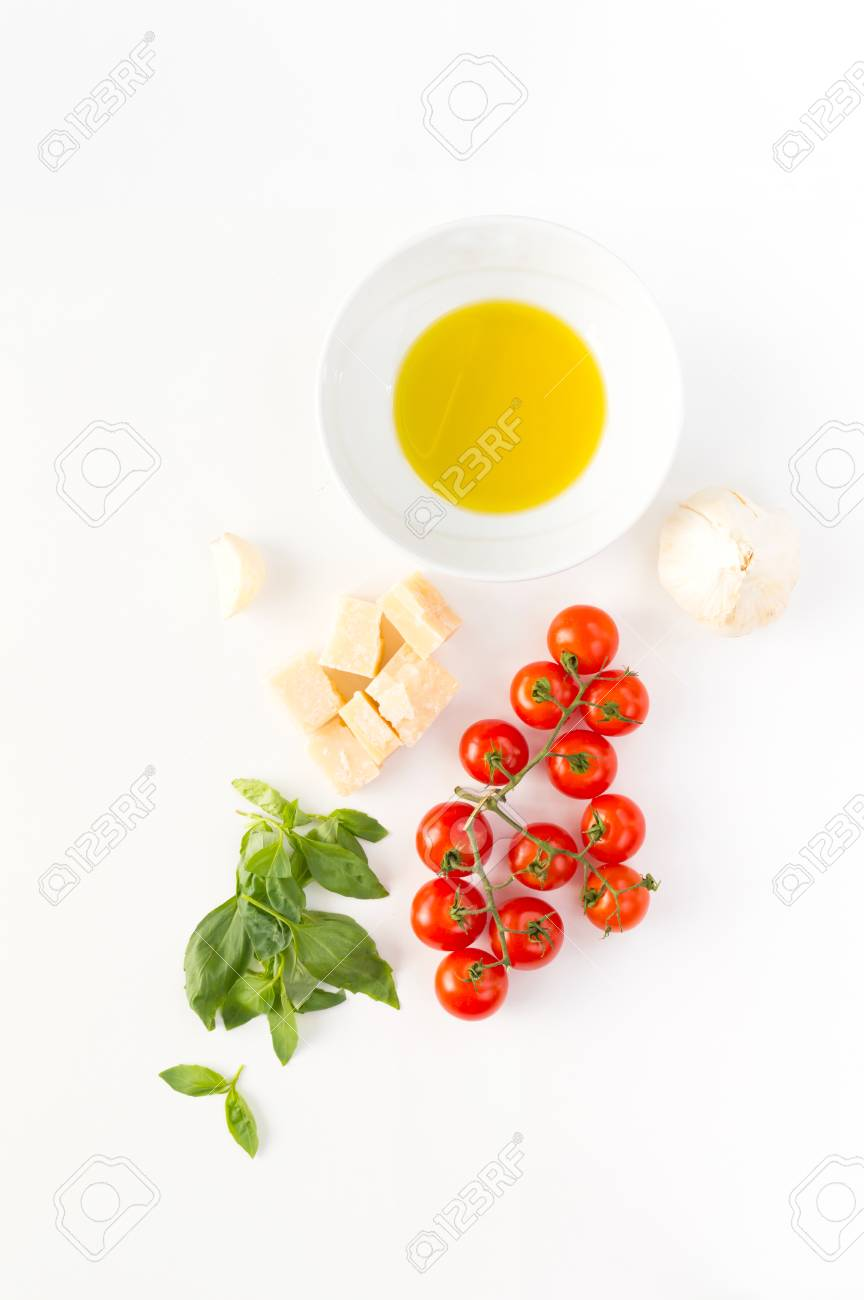 Italian food with red tomatoes, pasta, basil leafs, cheese, garlic, isolated on white background Stock Photo - 80170544