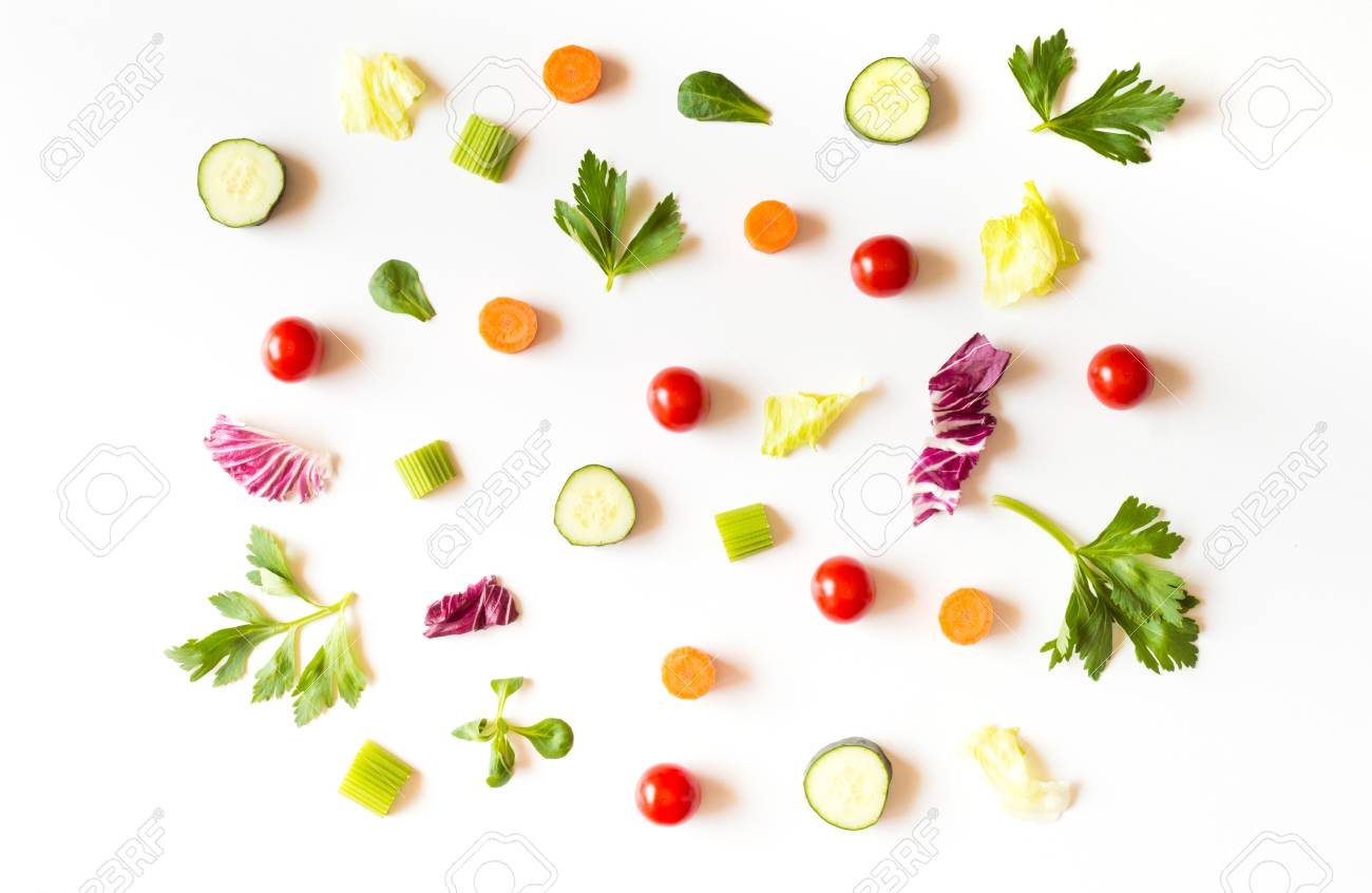 Eating pattern with raw ingredients of salad, lettuce leaves, cucumbers, red tomatoes, carrots, celery on white background Stock Photo - 80477376