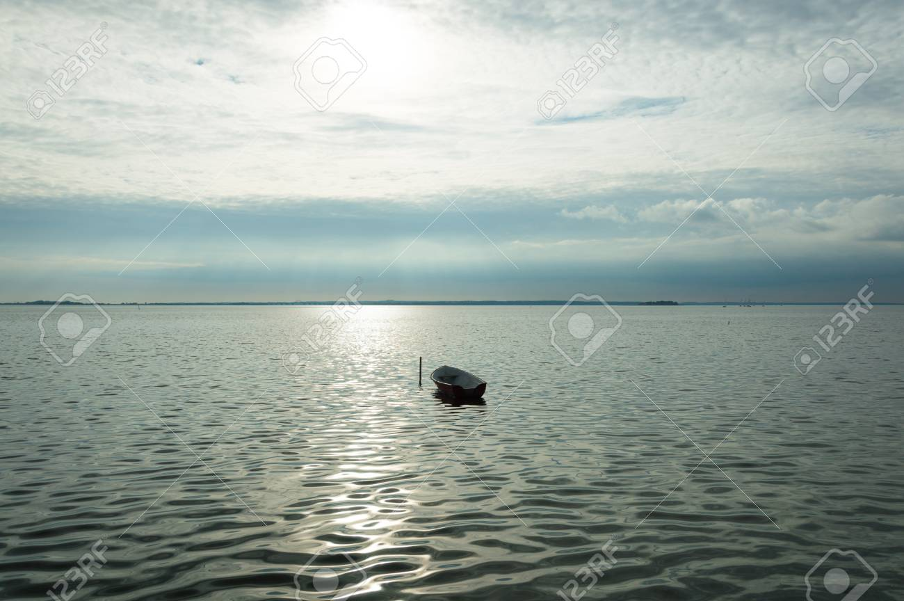 Alone boat on Denmark. Fjord on sea with cloudy sky Stock Photo - 91977892