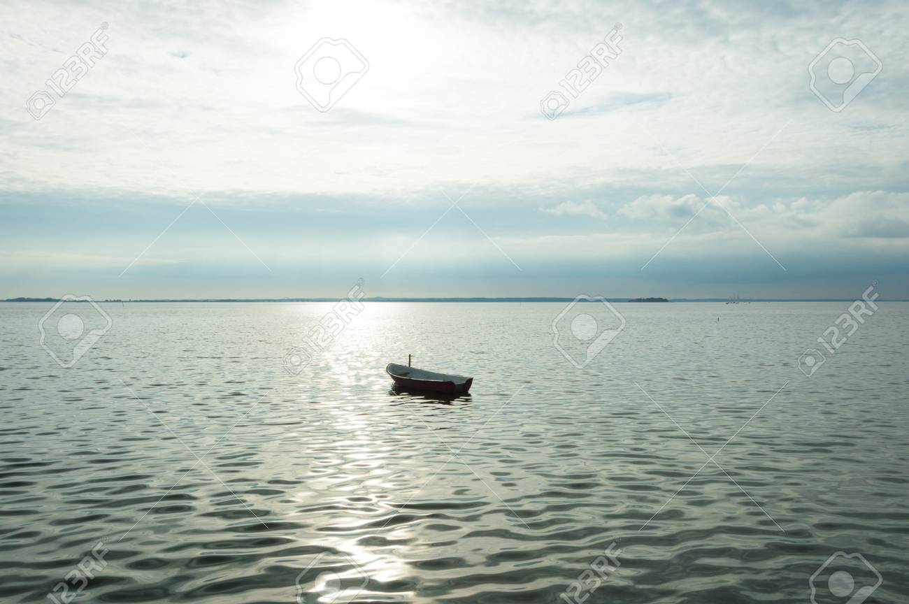 Alone boat on Denmark. Fjord on sea with cloudy sky Stock Photo - 91977893