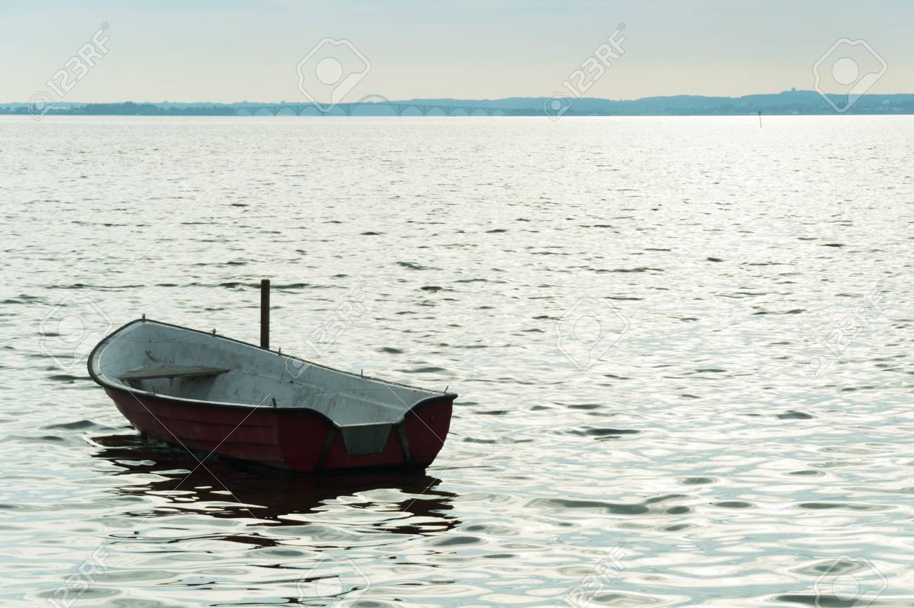 Alone boat on Denmark. Fjord on sea with cloudy sky Stock Photo - 91977894