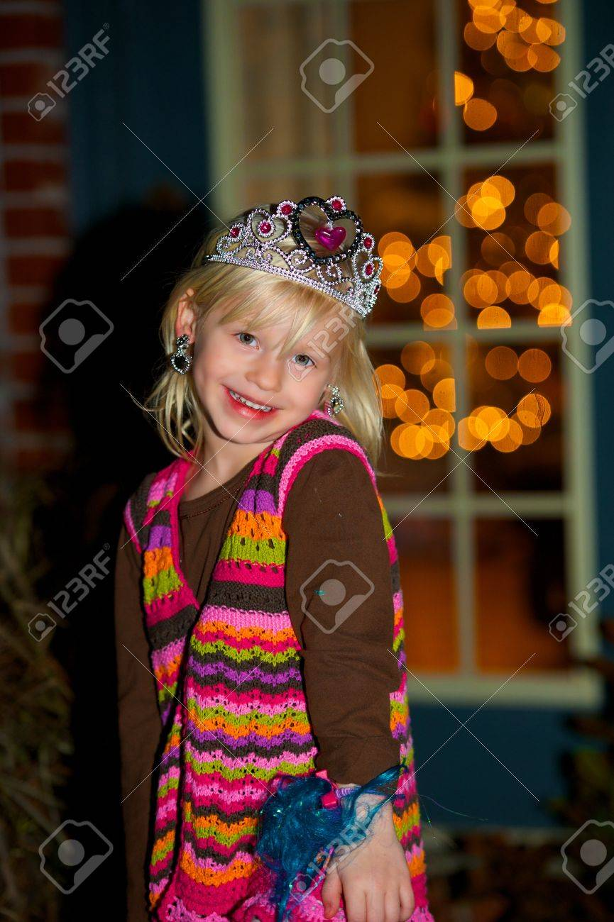 Darling Little Girl Wearing Princess Crown And Earrings Stock Photo   18787146