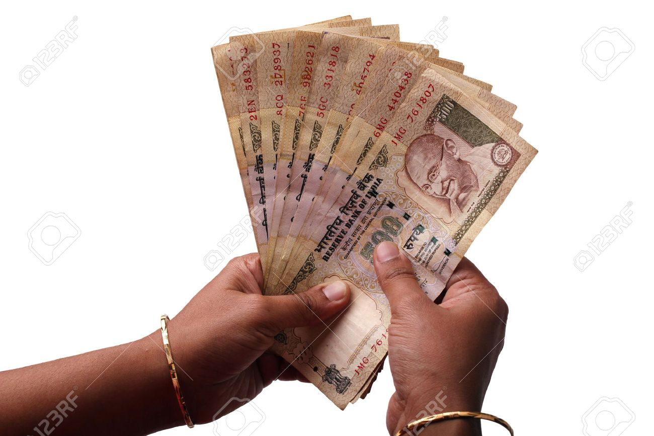 Woman counting a stch of 500 rupees notes Stock Photo - 10227230