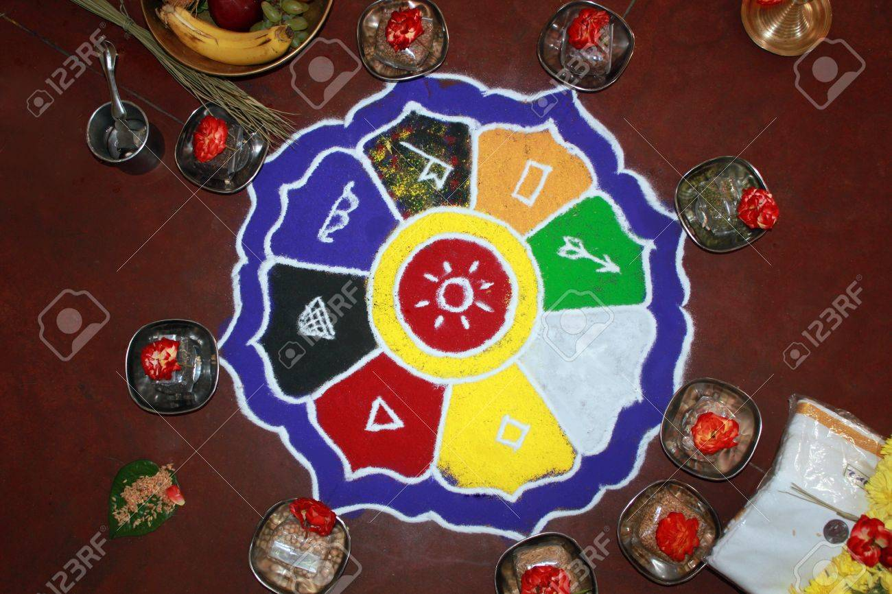 Colorful rangoli art with hindu puja items, flowers, dhoti and money Stock Photo - 12768987