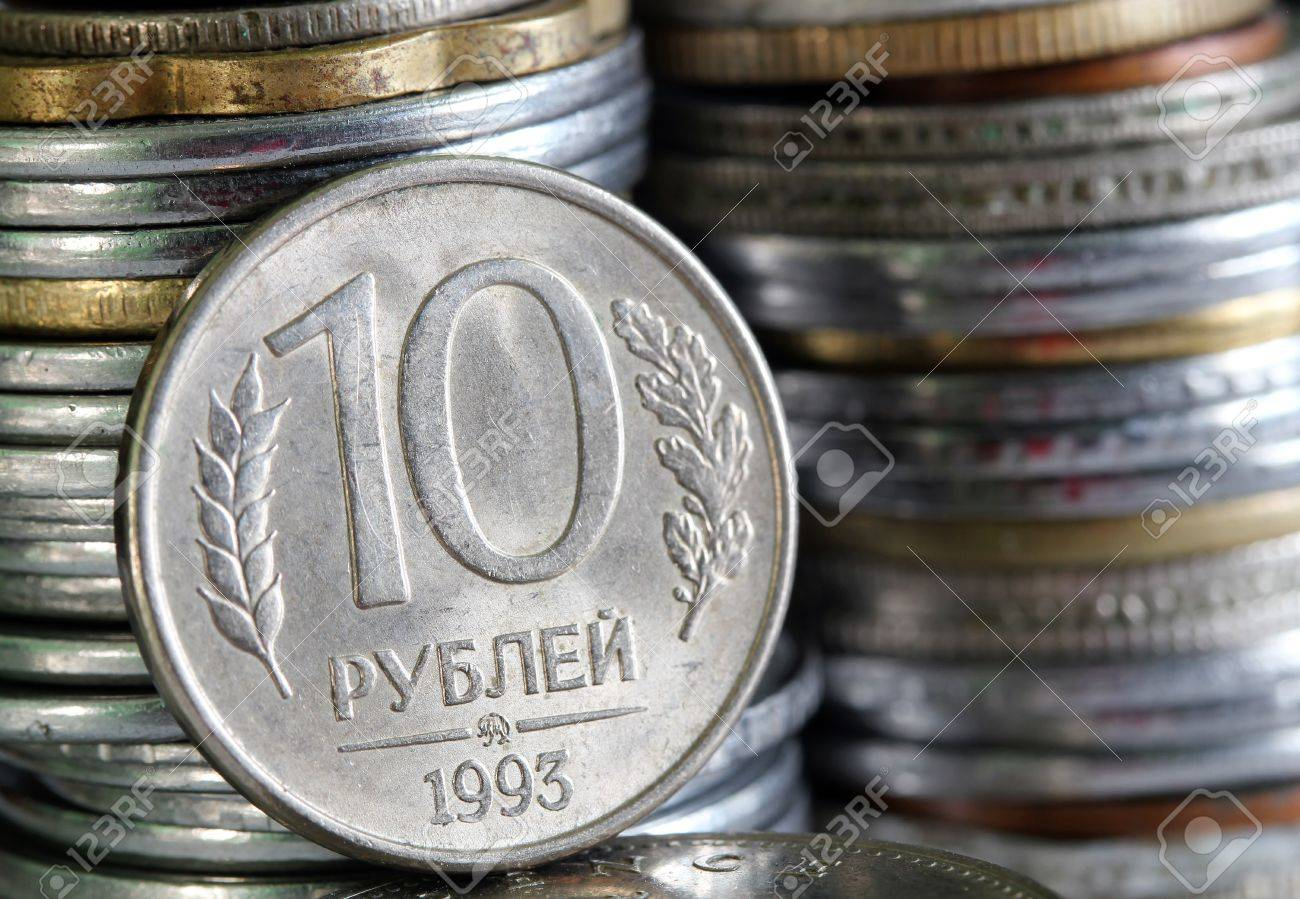 Russian rouble or ruble currency coin with stack of coins piled in the background Stock Photo - 13858901