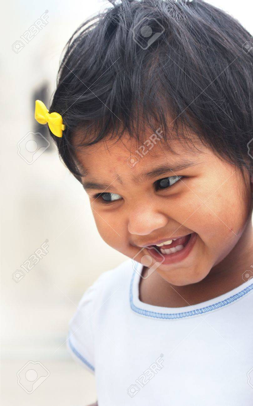 41da8ced1 Photo of beautiful and blissful indian baby girl with expressive eyes and  photogenic face expressing toddler's innocence with a pretty smile. The  child is ...