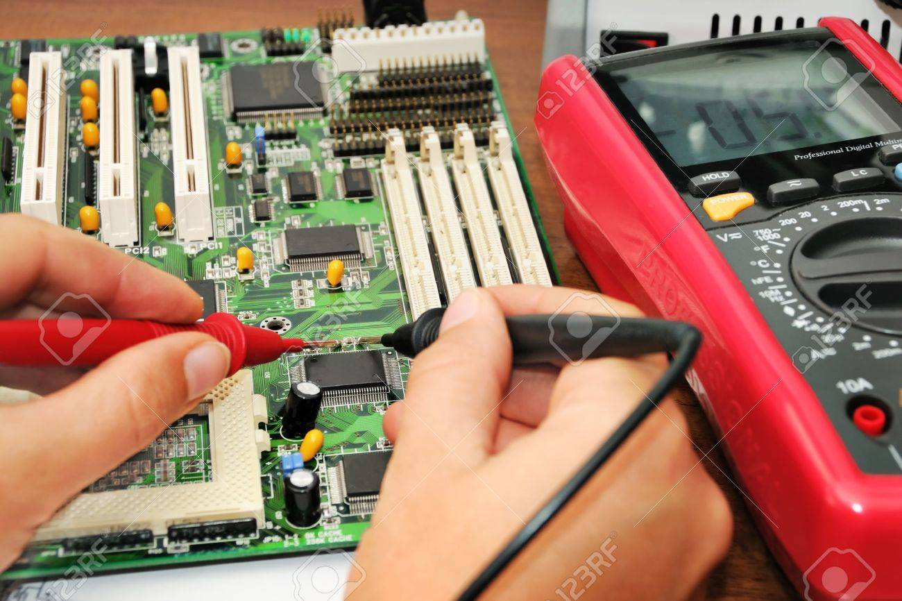 Technician In The Lab Testing A Circuit Board With Multimeter Stock Electronics Test For Series Including Voltmeter Photo