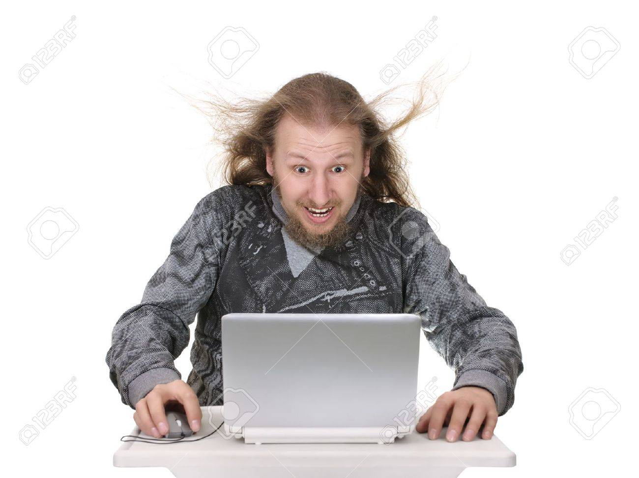 Man looking at his laptop with wind blowing from the monitor Stock Photo - 13298365