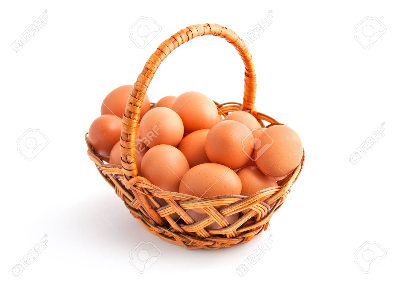 Chicken eggs in a basket isolated on white with shadow Stock Photo - 17114188