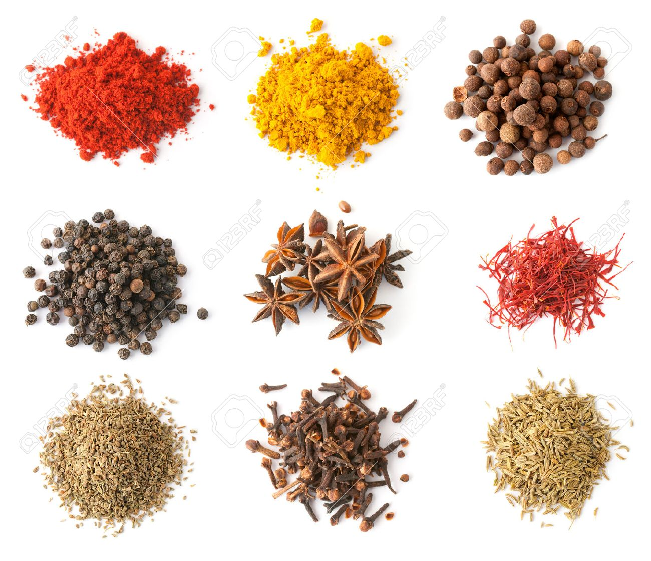 Set of spices (red and black pepper, allspice, saffron, curry, anise, cloves, cumin, coriander) isolated on white, top view - 36868479