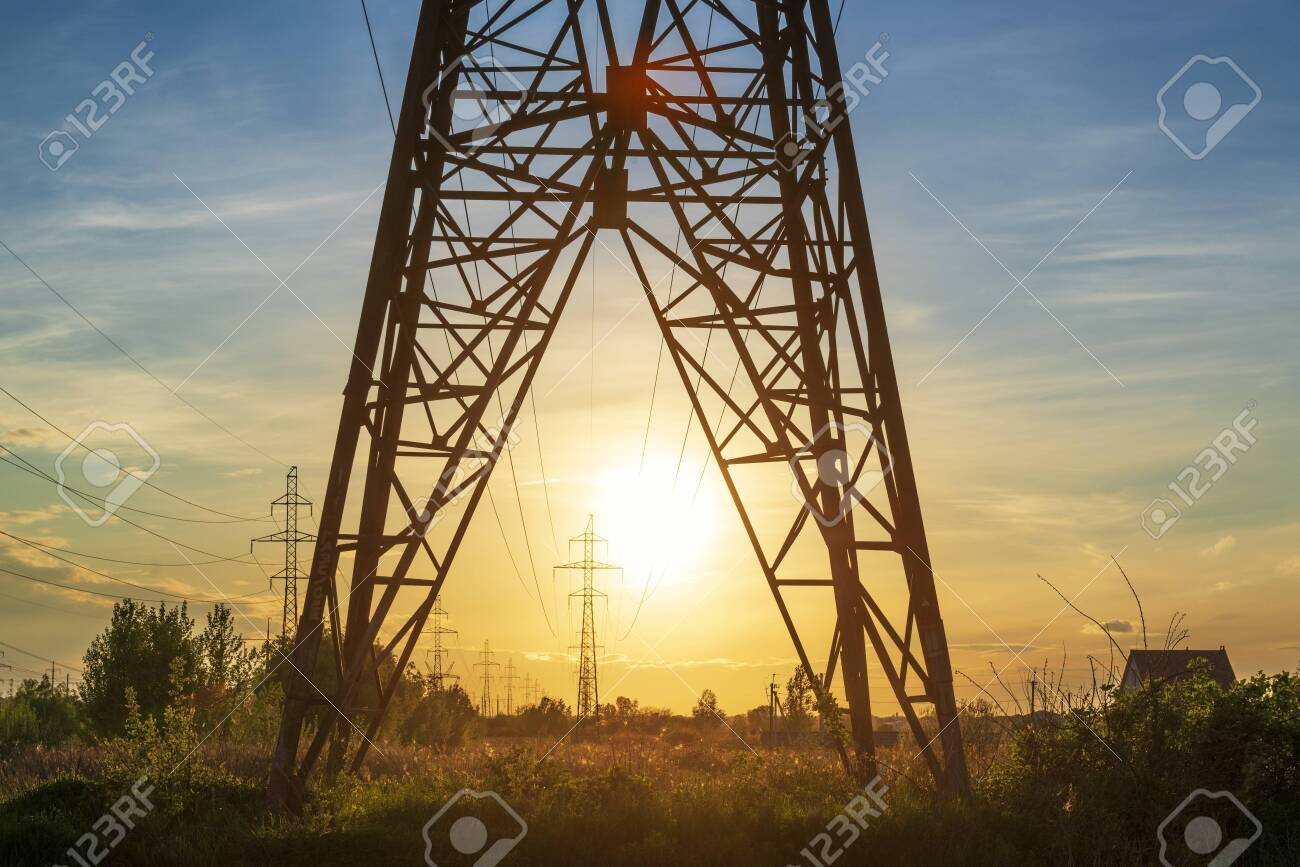 Power line support tower and sunset sun. Induastrial landscape - 147682259