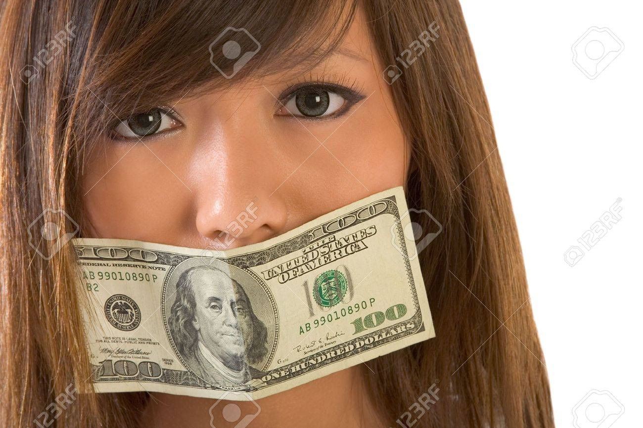 Asian girl with mouth gaged by 100 dollar bill Stock Photo - 1735872