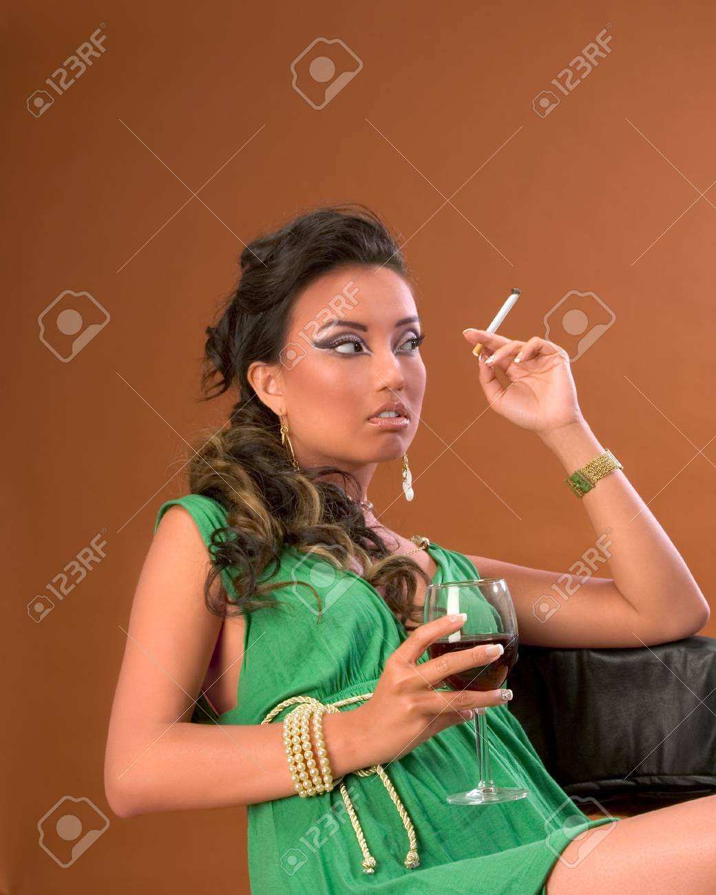 Young woman with cigarette and glass of red wine Stock Photo - 2387504