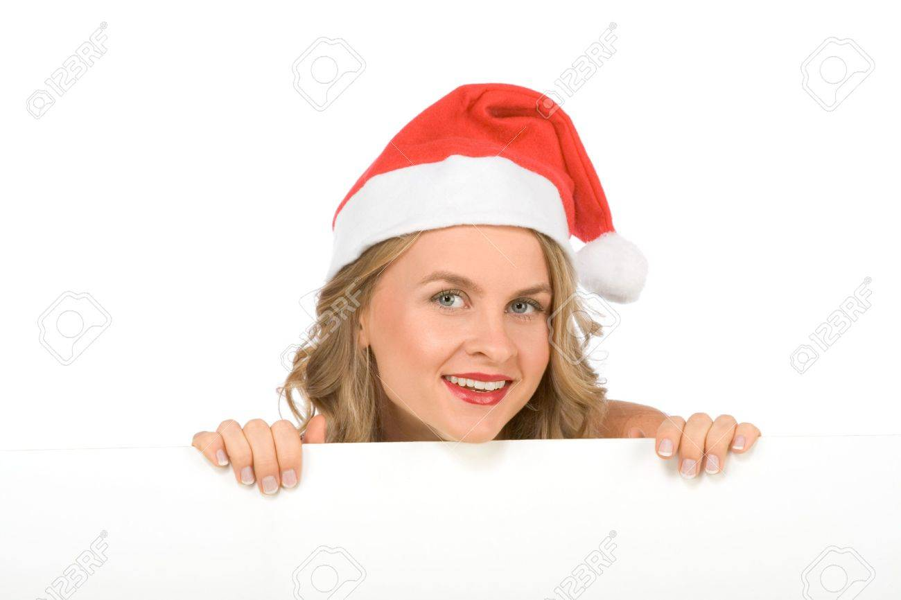 Sexy blonde young woman in Mrs Santa Claus hat holding a blank sign. Isolated on white. Extra white space with your message can be added to the bottom of the picture Stock Photo - 3605613