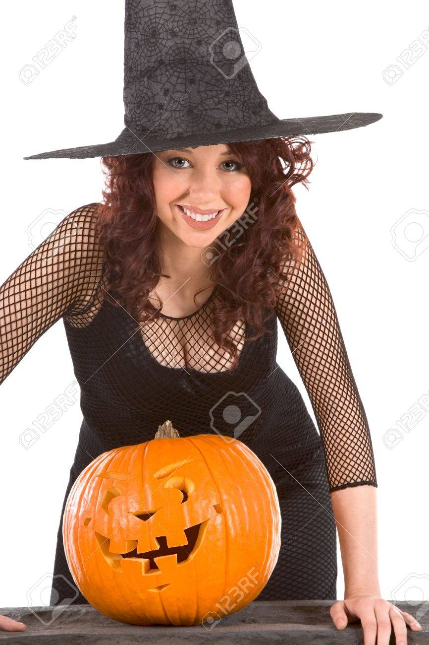 Portrait of busty Latina teenager girl in black Halloween hat and fishnet dress with carved pumpkin (Jack O' Lantern) Stock Photo - 3646706