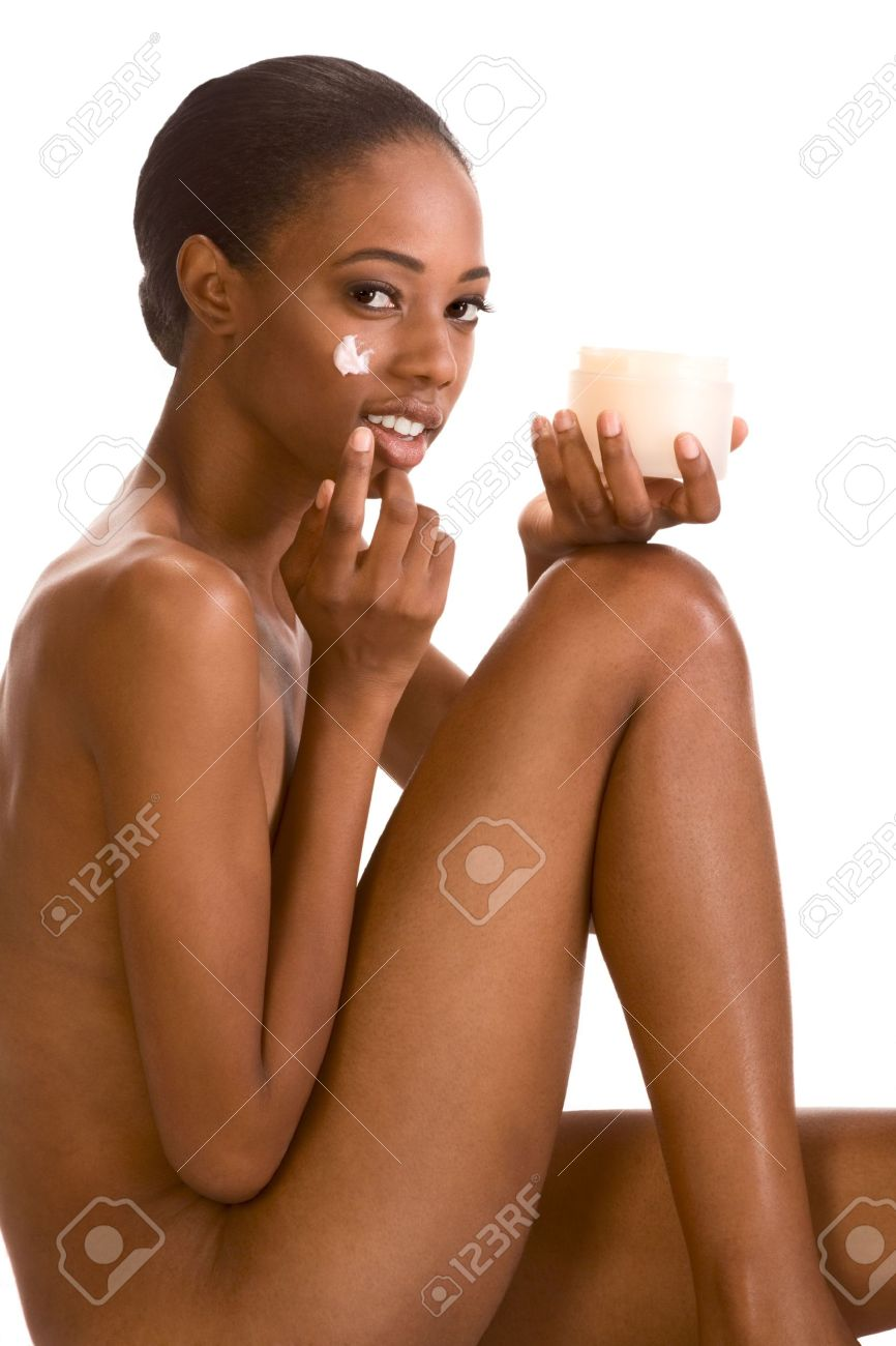 Beautiful nude young African American woman with Slicked Back Hair applying moisturizer on her face Stock Photo - 3767029
